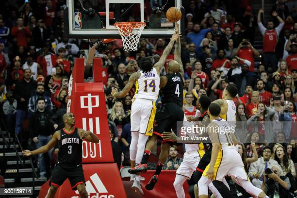 Tucker of the Houston Rockets goes up for a lay up defended by Brandon Ingram of the Los Angeles Lakers in the second overtime period at Toyota...