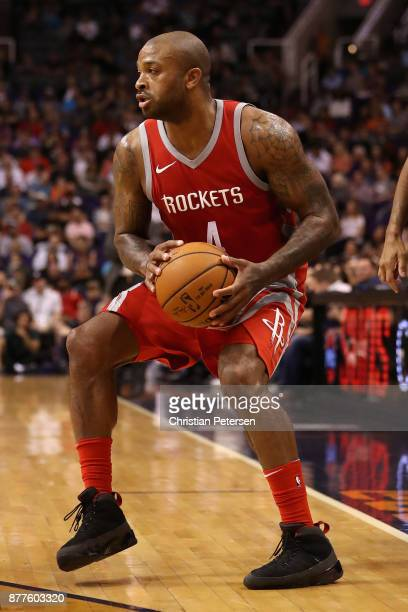 Tucker of the Houston Rockets handles the ball during the first half of the NBA game against the Phoenix Suns at Talking Stick Resort Arena on...