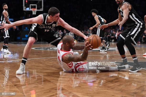 Tucker of the Houston Rockets handles the ball from the floor against Joe Harris of the Brooklyn Nets during the game at Barclays Center on February...