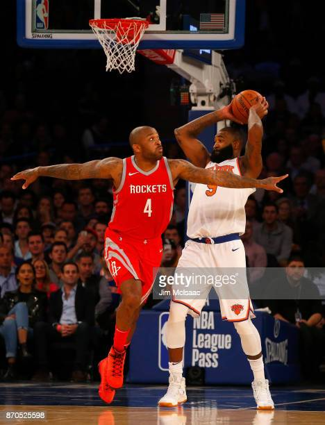PJ Tucker of the Houston Rockets in action against Kyle O'Quinn of the New York Knicks at Madison Square Garden on November 1 2017 in New York City...