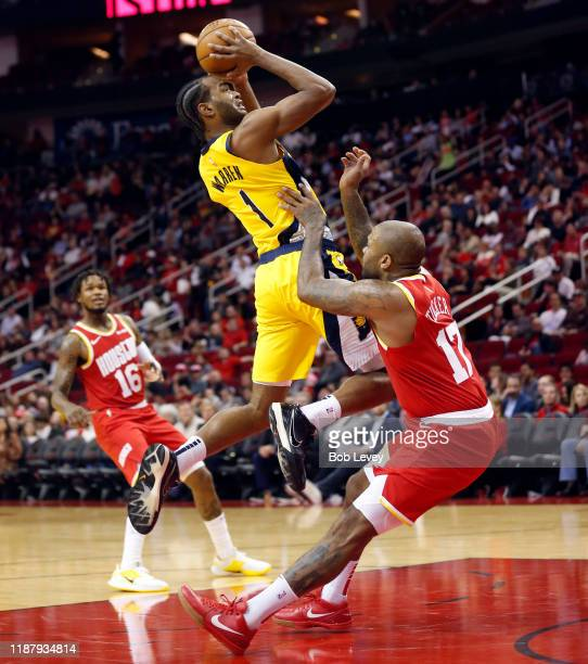 Tucker of the Houston Rockets is called for a block as TJ Warren of the Indiana Pacers drives to the basket at Toyota Center on November 15 2019 in...