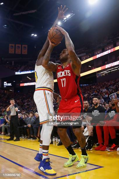 J Tucker of the Houston Rockets is guarded by Draymond Green of the Golden State Warriors in the first half at Chase Center on February 20 2020 in...