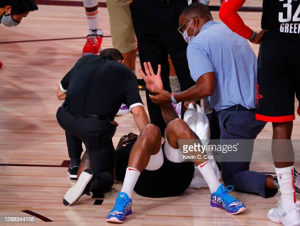 Tucker of the Houston Rockets is looked at by trainers during the third quarter against the Oklahoma City Thunder in Game Four of the Western...