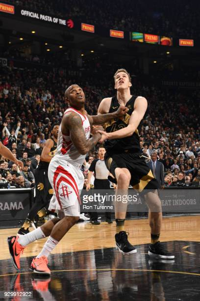 Tucker of the Houston Rockets plays defense against Jakob Poeltl of the Toronto Raptors on March 9 2018 at the Air Canada Centre in Toronto Ontario...