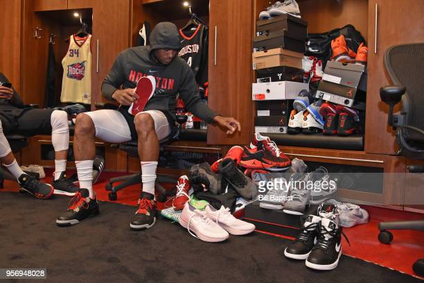 Tucker of the Houston Rockets puts on his sneakers by his locker before Game One of the Western Conference Semifinals against the Utah Jazz during...