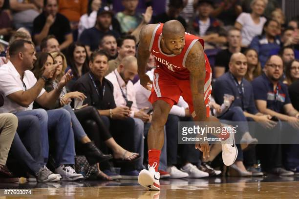 Tucker of the Houston Rockets reacts to a three point shot against the Phoenix Suns during the second half of the NBA game at Talking Stick Resort...
