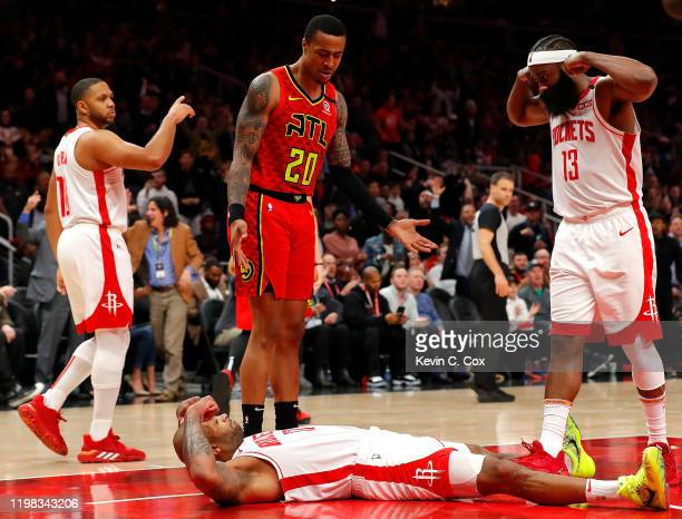 Tucker of the Houston Rockets reacts towards James Harden after drawing a charge from Alex Len of the Atlanta Hawks to force a turnover in the second...