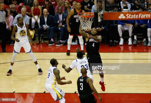 Tucker of the Houston Rockets shoots against Draymond Green of the Golden State Warriors in the second half of Game Two of the Western Conference...