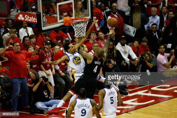 Tucker of the Houston Rockets shoots against Shaun Livingston of the Golden State Warriors in the first half of Game Two of the Western Conference...