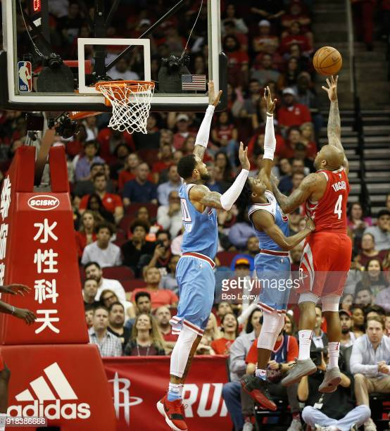 Tucker of the Houston Rockets shoots over De'Aaron Fox of the Sacramento Kings and Willie CauleyStein at Toyota Center on February 14 2018 in Houston...