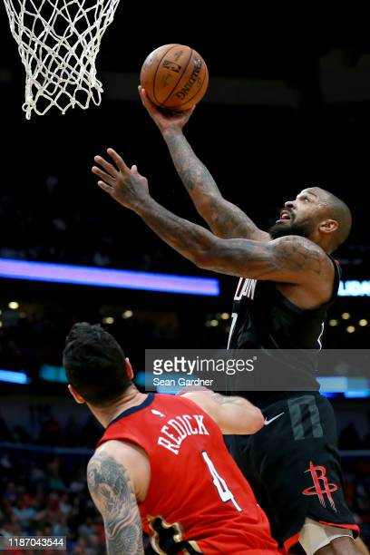 Tucker of the Houston Rockets shoots over JJ Redick of the New Orleans Pelicans during a NBA game at the Smoothie King Center on November 11 2019 in...