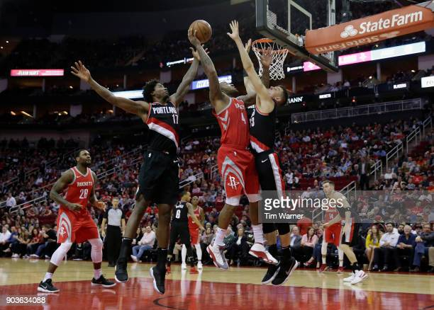 Tucker of the Houston Rockets shoots the ball defended by Zach Collins of the Portland Trail Blazers and Ed Davis in the second half at Toyota Center...