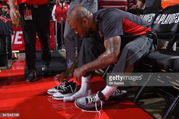 Tucker of the Houston Rockets switches his sneakers before Game One of Round One of the 2018 NBA Playoffs against the Minnesota Timberwolves on April...