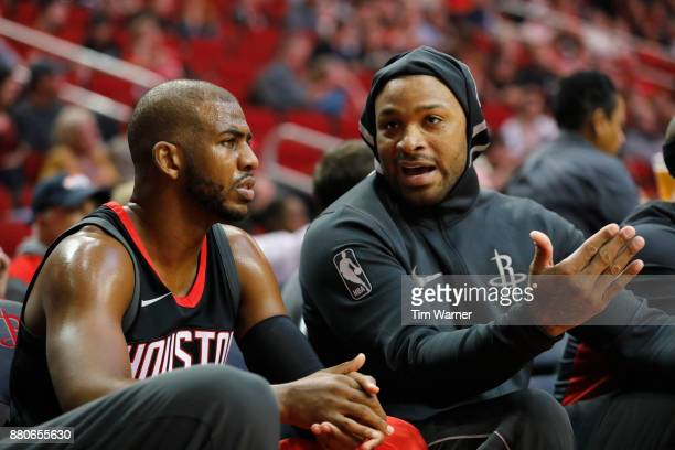 Tucker of the Houston Rockets talks with Chris Paul on the bench in the first half against the Brooklyn Nets at Toyota Center on November 27 2017 in...