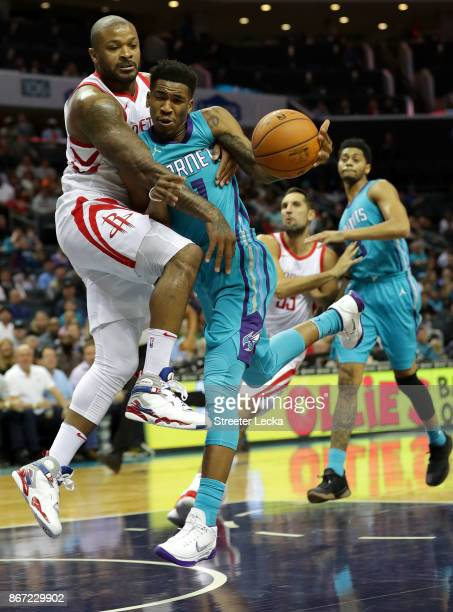 Tucker of the Houston Rockets tries to stop Malik Monk of the Charlotte Hornets during their game at Spectrum Center on October 27, 2017 in...