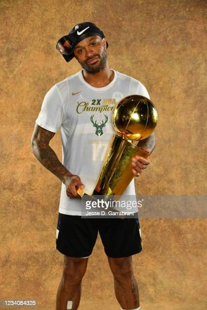 Tucker of the Milwaukee Bucks poses for a portrait with the Larry O'Brien Trophy after winning Game Six of the 2021 NBA Finals against the Phoenix...