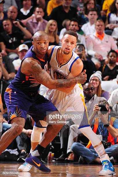 J Tucker of the Phoenix Suns battles to guard Stephen Curry of the Golden State Warriors on February 10 at Talking Stick Resort Arena in Phoenix...