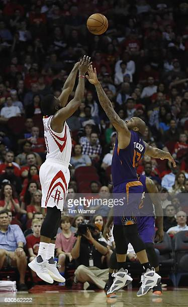 J Tucker of the Phoenix Suns defends a three point shot by James Harden of the Houston Rockets in the first half at Toyota Center on December 26 2016...