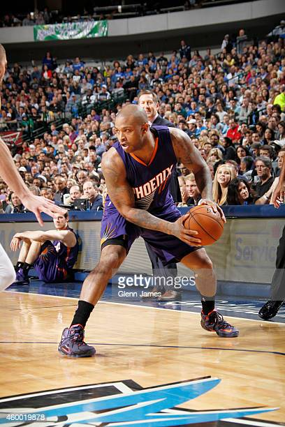J Tucker of the Phoenix Suns defends the ball against the Dallas Mavericksduring the game on December 5 2014 at American Airlines Center in Dallas...