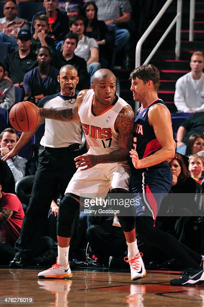 J Tucker of the Phoenix Suns drives against the Atlanta Hawks on March 2 2014 at US Airways Center in Phoenix Arizona NOTE TO USER User expressly...