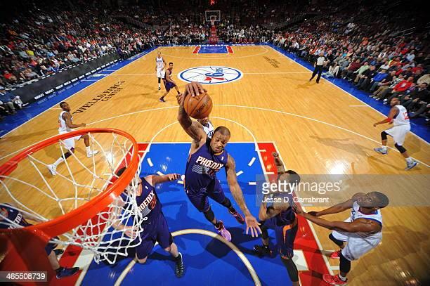 J Tucker of the Phoenix Suns grabs a rebound against the Philadelphia 76ers at the Wells Fargo Center on January 27 2014 in Philadelphia Pennsylvania...