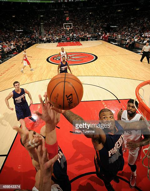 PJ Tucker of the Phoenix Suns grabs a rebound against the Toronto Raptors on November 24 2014 at the Air Canada Centre in Toronto Ontario Canada NOTE...