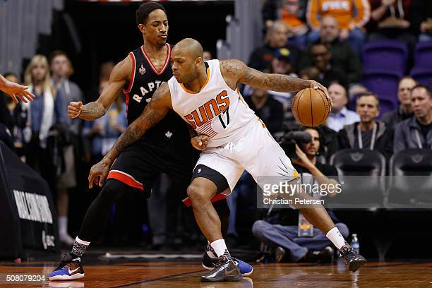 J Tucker of the Phoenix Suns handles the ball against DeMar DeRozan of the Toronto Raptors during the first half of the NBA game at Talking Stick...