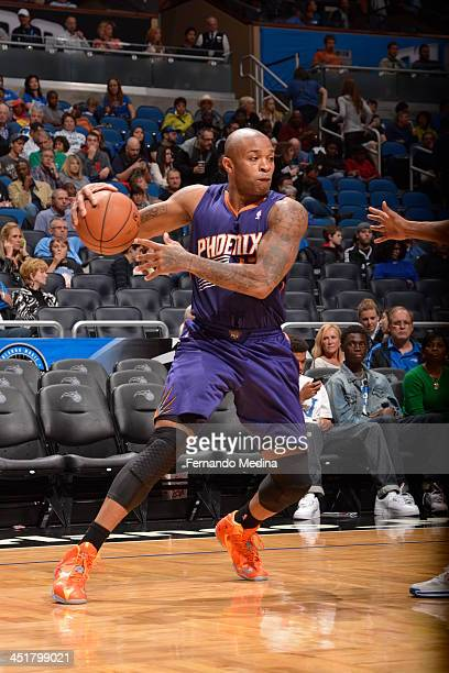 J Tucker of the Phoenix Suns handles the ball against the Orlando Magic on November 24 2013 at Amway Center in Orlando Florida NOTE TO USER User...