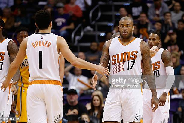 J Tucker of the Phoenix Suns highfives Devin Booker during the second half of the NBA game against the Indiana Pacers at Talking Stick Resort Arena...