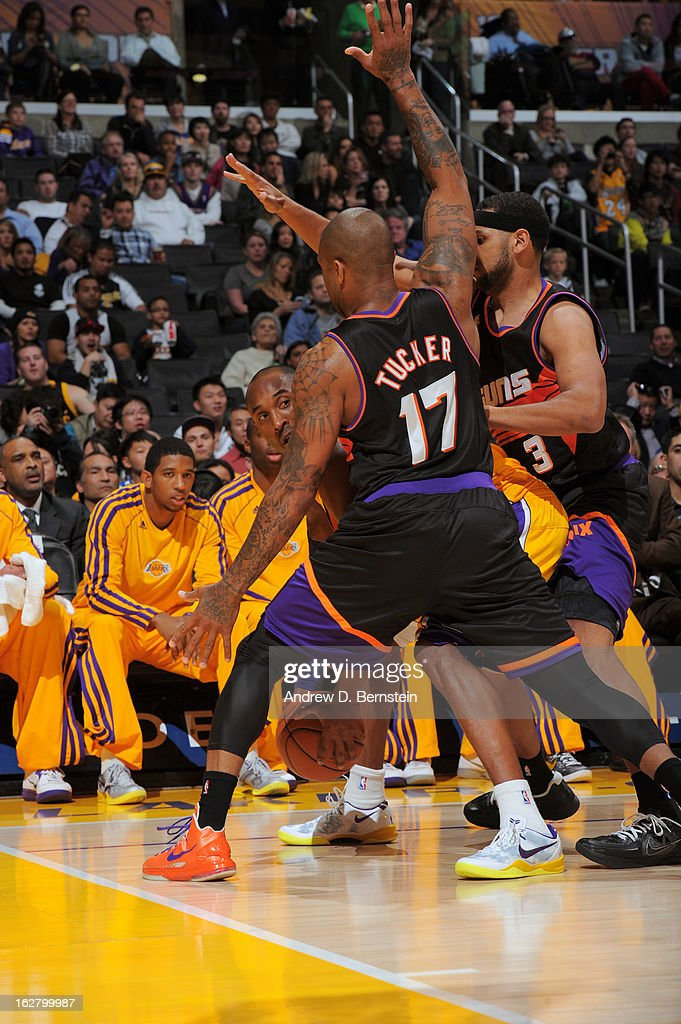 P.J. Tucker #17 of the Phoenix Suns plays defense against Kobe Bryant #24 of the Los Angeles Lakers at Staples Center on February 12, 2013 in Los Angeles, California.