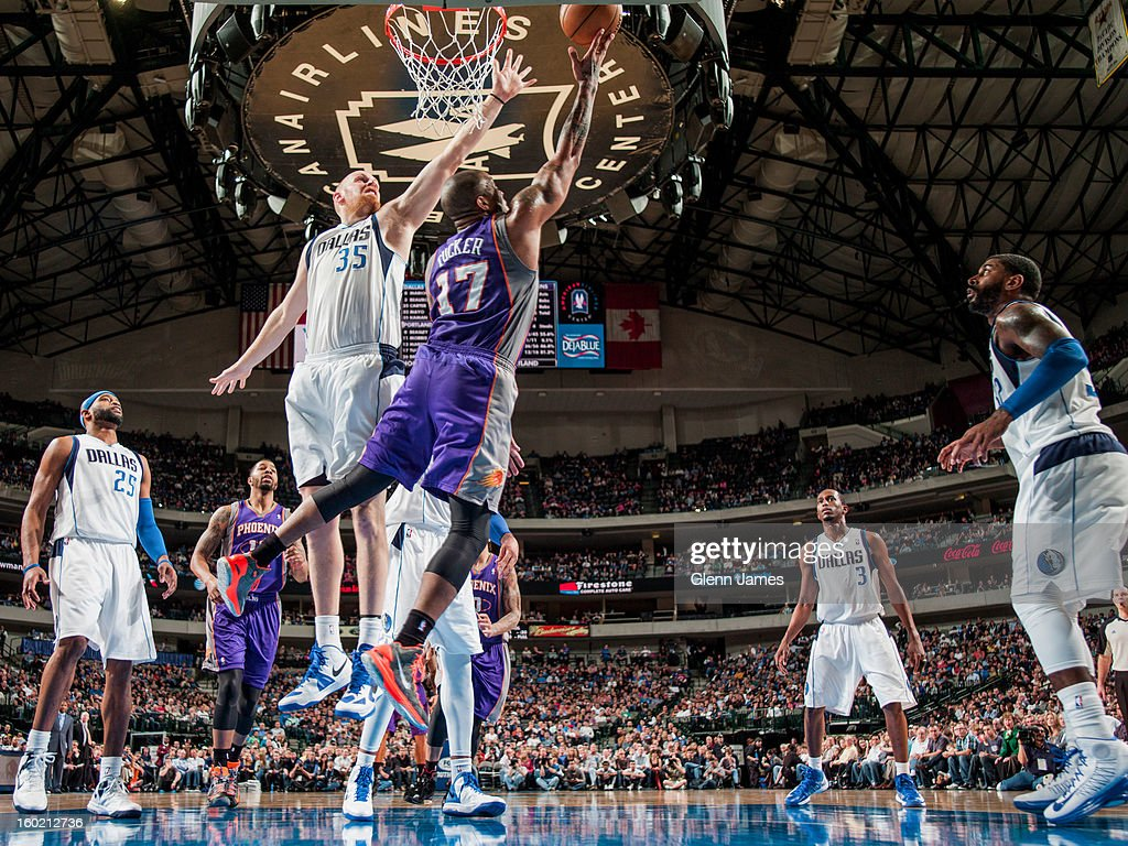 P.J. Tucker #17 of the Phoenix Suns shoots a reverse layup against Chris Kaman #35 of the Dallas Mavericks on January 27, 2013 at the American Airlines Center in Dallas, Texas.