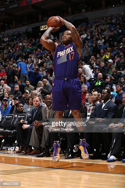 J Tucker of the Phoenix Suns shoots against the Minnesota Timberwolves on March 23 2014 at Target Center in Minneapolis Minnesota NOTE TO USER User...