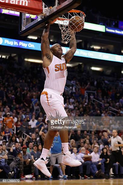 J Tucker of the Phoenix Suns slam dunks the ball against the Cleveland Cavaliers during the second half of the NBA game at Talking Stick Resort Arena...