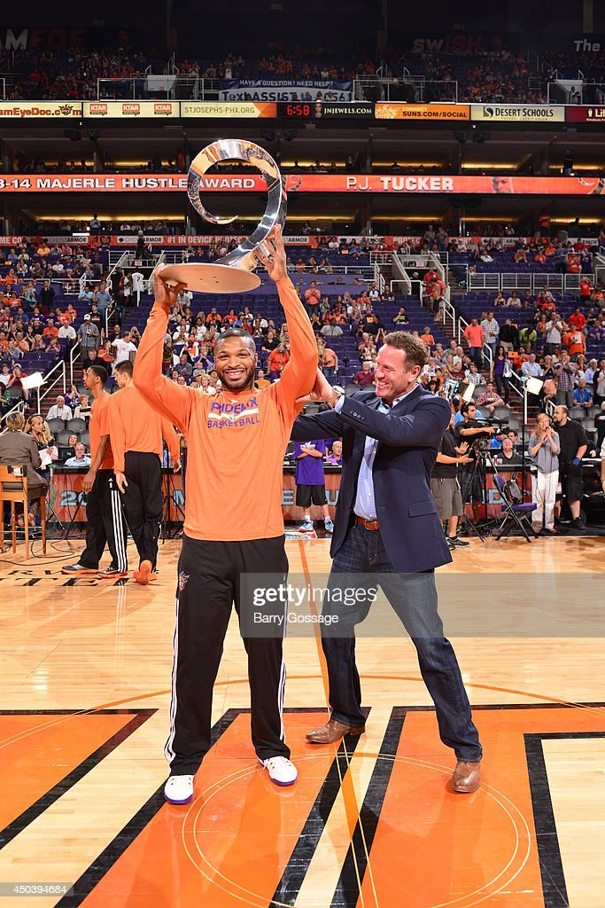P.J. Tucker #17 of the Phoenix Suns was presented with the 2013-14 Majerle Hustle Award by Former Suns player, Dan Majerle, before the game against the Memphis Grizzlies at US Airways Center in Phoenix, Arizona. Tucker becomes the first back-to-back winner of the award.