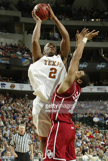 J Tucker of the Texas Longhorns shoots over De'Angelo Alexander of the Oklahoma Sooners in the second half during the quarterfinals of the Phillips...