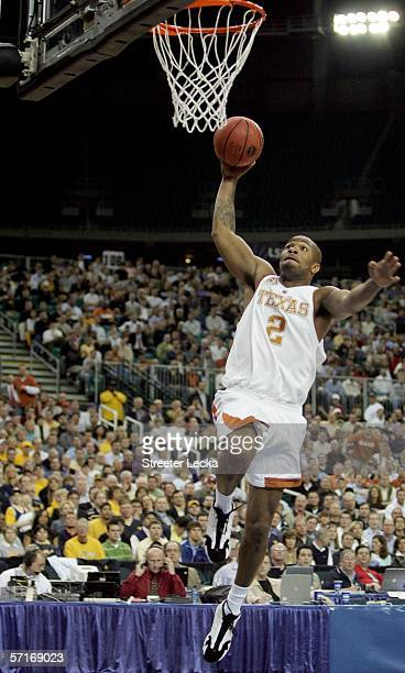 Tucker of the Texas Longhorns shoots over the defense of the West Virginia Mountaineers during third round game of the 2006 NCAA Division I Men's...