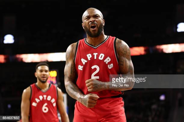 J Tucker of the Toronto Raptors celebrates after a Detroit Pistons turnover late in the in the second half at the Palace of Auburn Hills on March 17...