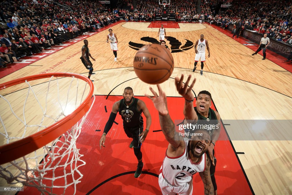 P.J. Tucker #2 of the Toronto Raptors goes up for a rebound against Giannis Antetokounmpo #34 of the Milwaukee Bucks in Round One of the Eastern Conference Playoffs during the 2017 NBA Playoffs on April 15, 2017 at the Air Canada Centre in Toronto, Ontario, Canada.