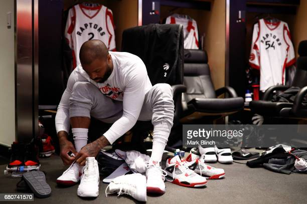 J Tucker of the Toronto Raptors ties his shoes before Game Four of the Eastern Conference Semifinals against the Cleveland Cavaliers during the 2017...