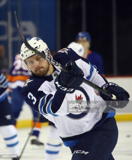 Tucker Poolman of the Winnipeg Jets takes the shot during warmups prior to the game against the New York Islanders at the Barclays Center on December...