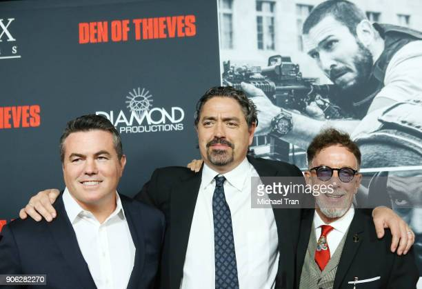 Tucker Tooley Christian Gudegast and Mark Canton arrive to Los Angeles premiere of STX Films' Den Of Thieves held at Regal LA Live Stadium 14 on...