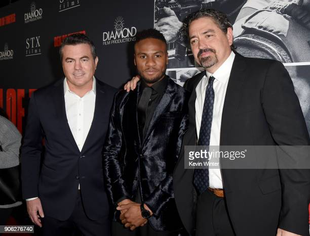 Tucker Tooley Ron J Rock and Christian Gudegast attend the premiere of STX Films' 'Den of Thieves' at Regal LA Live Stadium 14 on January 17 2018 in...