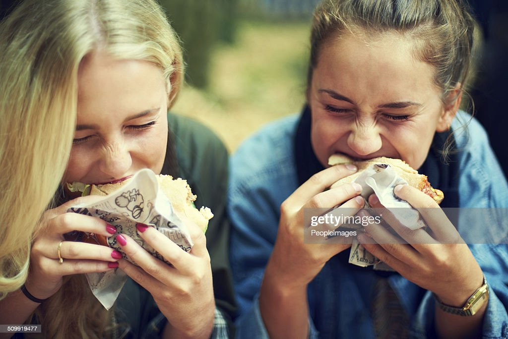 Tucking into some tastiness : Stock Photo