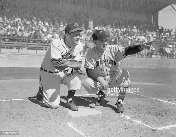 Managers Meet as Mel Ott of the New York Giants and Lou Boudreau head man of the Cleveland Indians are shown getting together for a moment prior to...