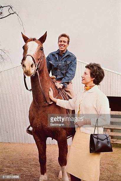 Tucson, Arizona....Princess Margaret appears enthused as Lord Snowdon sits astride a horse at ranch owned by Lewis Douglas, former US ambassador to...