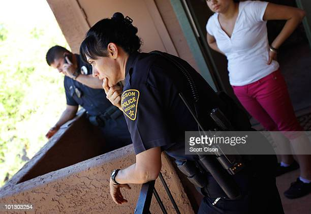 Tucson Police Officer Ysela Welding talks with a young woman who fears her father went out into the desert to commit suicide May 30 2010 in Tucson...