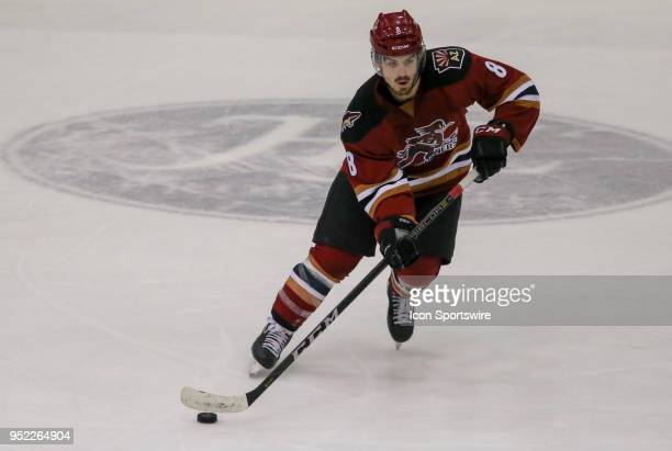 Tucson Roadrunners right wing Conor Garland controls the puck during a hockey game between the Chicago Wolves and Tuscon Roadrunners on April 27 at...