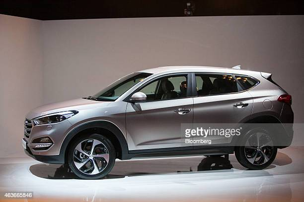 A Tucson sports utility vehicle manufactured by Hyundai Motor Co is unveiled in Berlin Germany on Tuesday Feb 17 2015 Industry executives including...