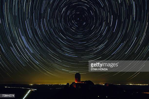 Stars appear to rotate around Polaris the north star in this time exposure 26 January above a view of the 4meter telescope dome at Kitt Peak National...