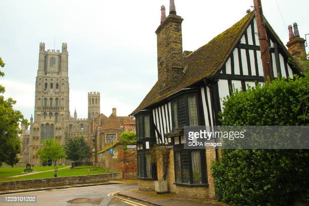 Tudor architecture cottage with the Ely Cathedral in the background The Anglican cathedral in Cambridgeshire England is closed in response to COVID19...